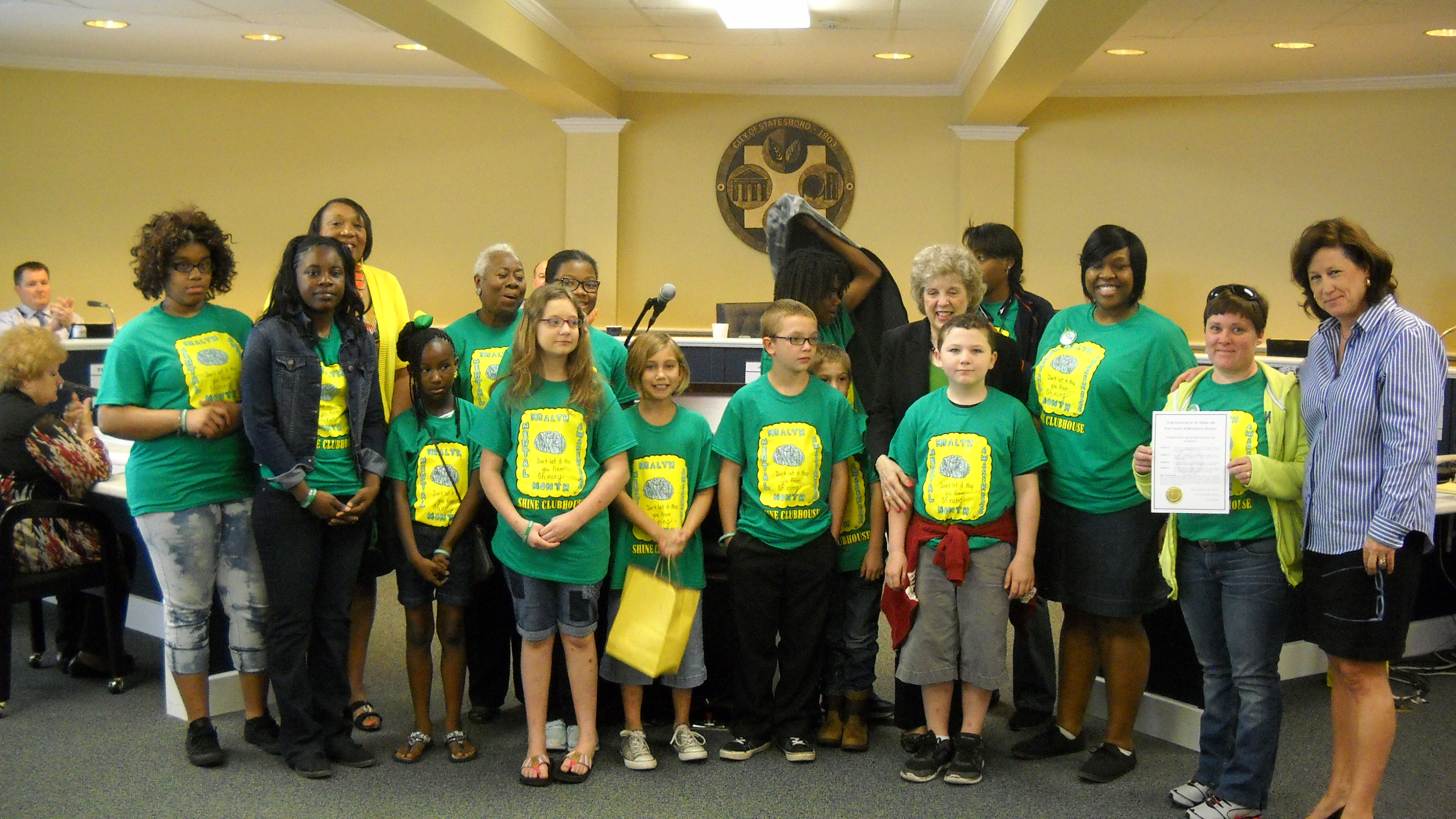 "SHINE clubhouse kids attended the signing of the proclamation by Statesboro Mayor Jan Moore declaring May 3 – 9, 2015 Children's Mental Health Week. Mayor Moore also recognized the youth for their work on ""Adopt a Spot,"" a local volunteer program that keeps public spaces clean."