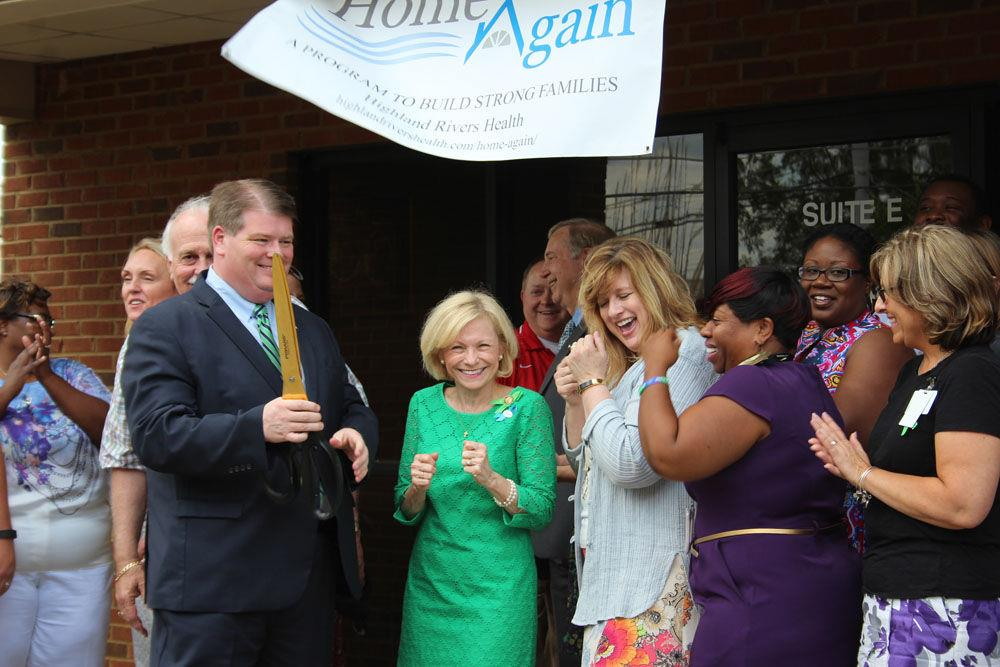 Highland Rivers Health board chair Chief Magistrate Allen Wigington (with scissors, from left), state Rep. Katie Dempsey (R-Rome), Highland Rivers CEO Melanie Dallas and Tawanda Scales with the Georgia Department of Behavioral Health and Developmental Disabilities, celebrate the opening of Highland Rivers' Home Again office at 1838 Redmond Circle Thursday.