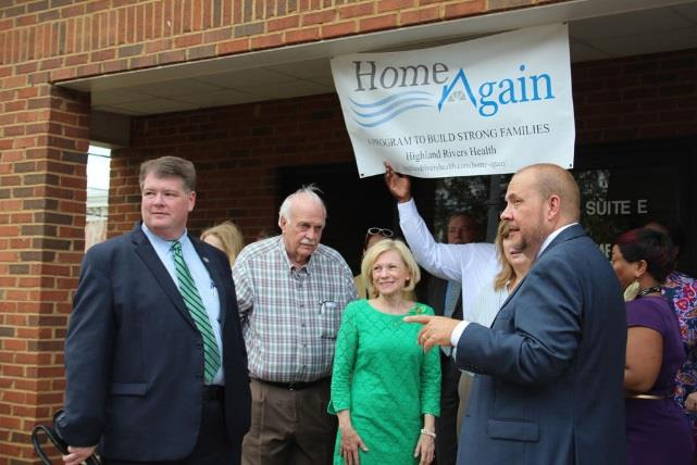 Highland Rivers Health board chair Chief Magistrate Allen Wigington (from left), Floyd County Commissioner Larry Maxey, state Rep. Katie Dempsey (R-Rome), Highland Rivers CEO Melanie Dallas and Michael Mullet, the organization' community relations director, celebrate the opening of its Home Again program office at 1838 Redmond Circle Thursday.